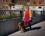 wbwoman-yellow-sunglasses-walking-dog
