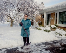 Portrait of Woman Shoveling after Storm